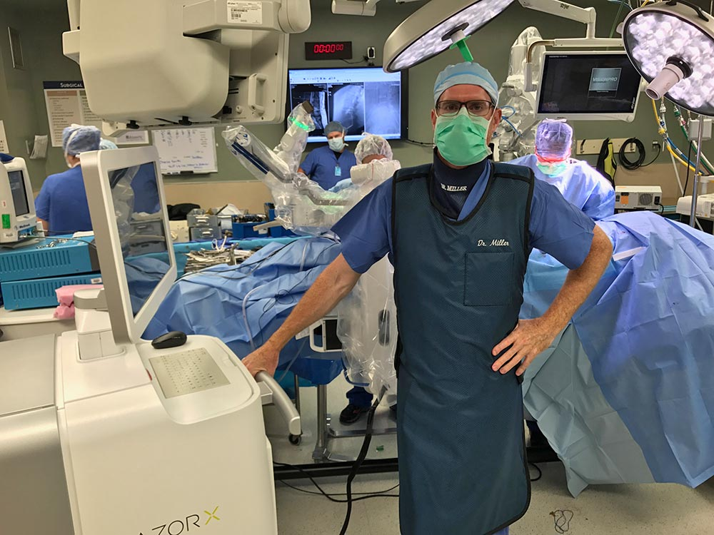 Dr Miller finishing a case with the Mazor X robot.